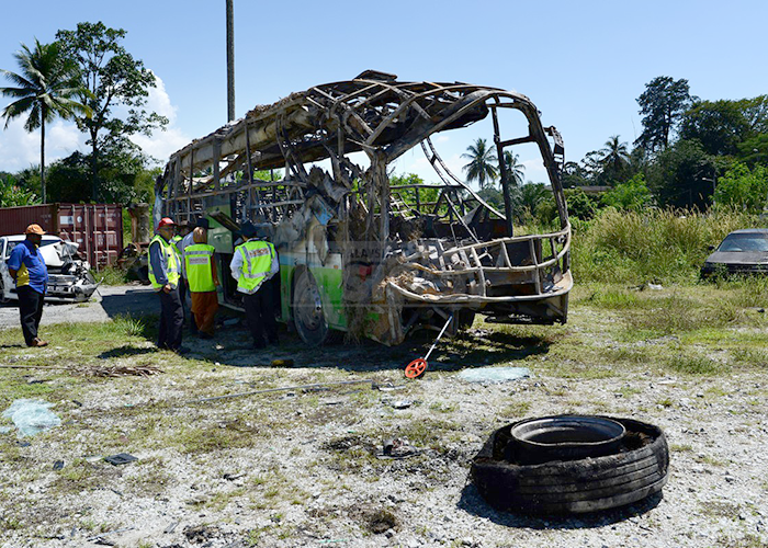 Eight killed and 22 injured after a tour bus in Malaysia overturns and catches fire
