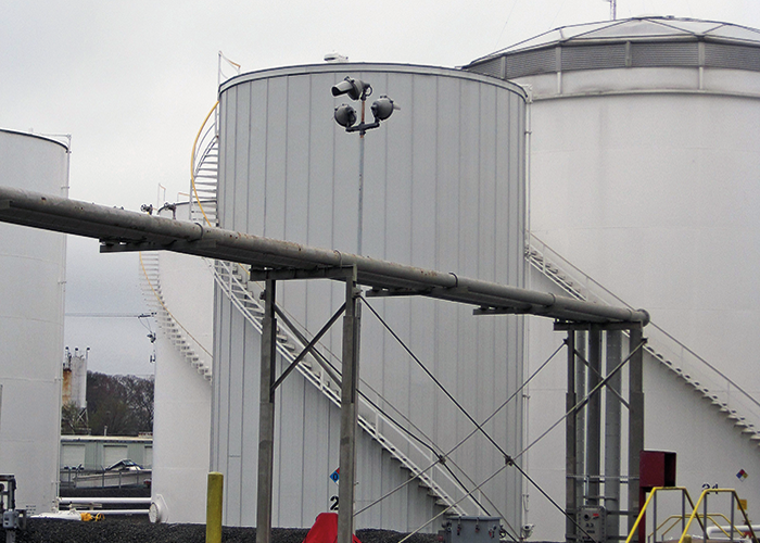 Domed External Floating Roof Tank next to Vertical Low Pressure Tank.