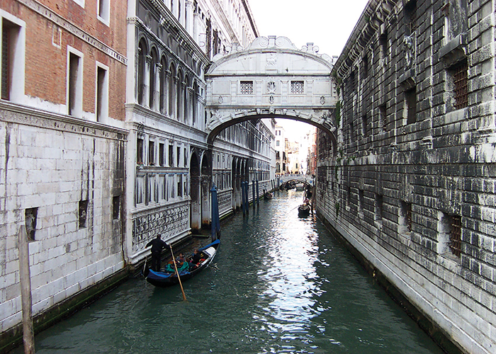The name 'Bridge of Sighs' comes from a poem by Lord Byron. Local Venetian legend says that if a couple kiss underneath the bridge at sunset they will have eternal love.