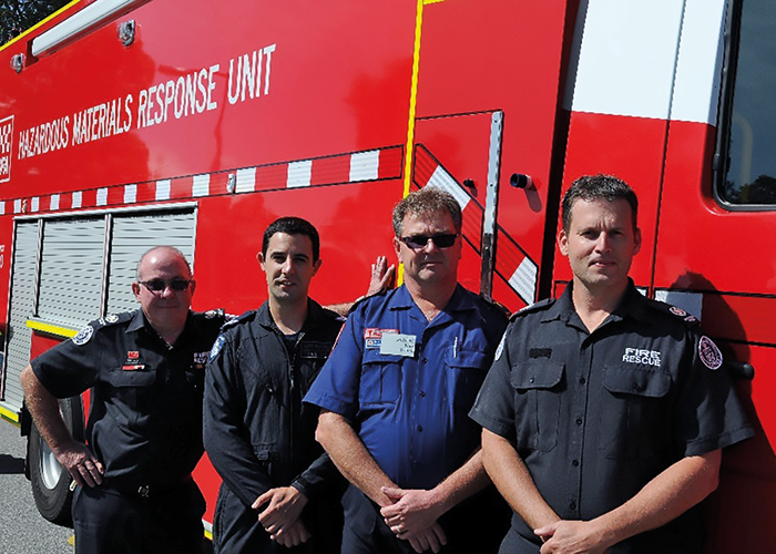 Members of the Victoria Country Fire Authority with Police and Ambulance personnel at a CBRNe training session.