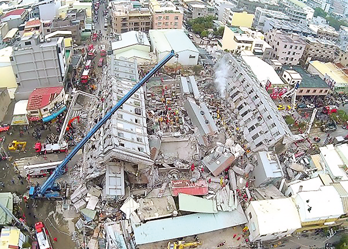 The Weiguan Jinlong residential building in Tainan after collapse. The surrounding buildings do not appear to have severe damage.
