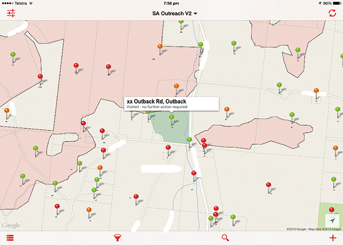 Screenshot showing real time map on tablet (Fires relief outreach). Red pins indicate properties to be visited, Green indicates those already visited. Orange indicate visited but no one home.