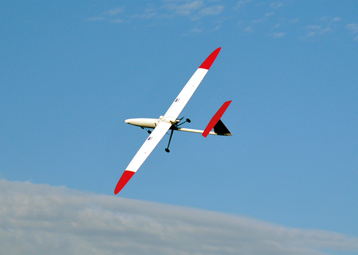 UAV of the same model as the evaluation version in flight. A 4kg payload including P25 digital payload was tested over southern NSW in late 2015.