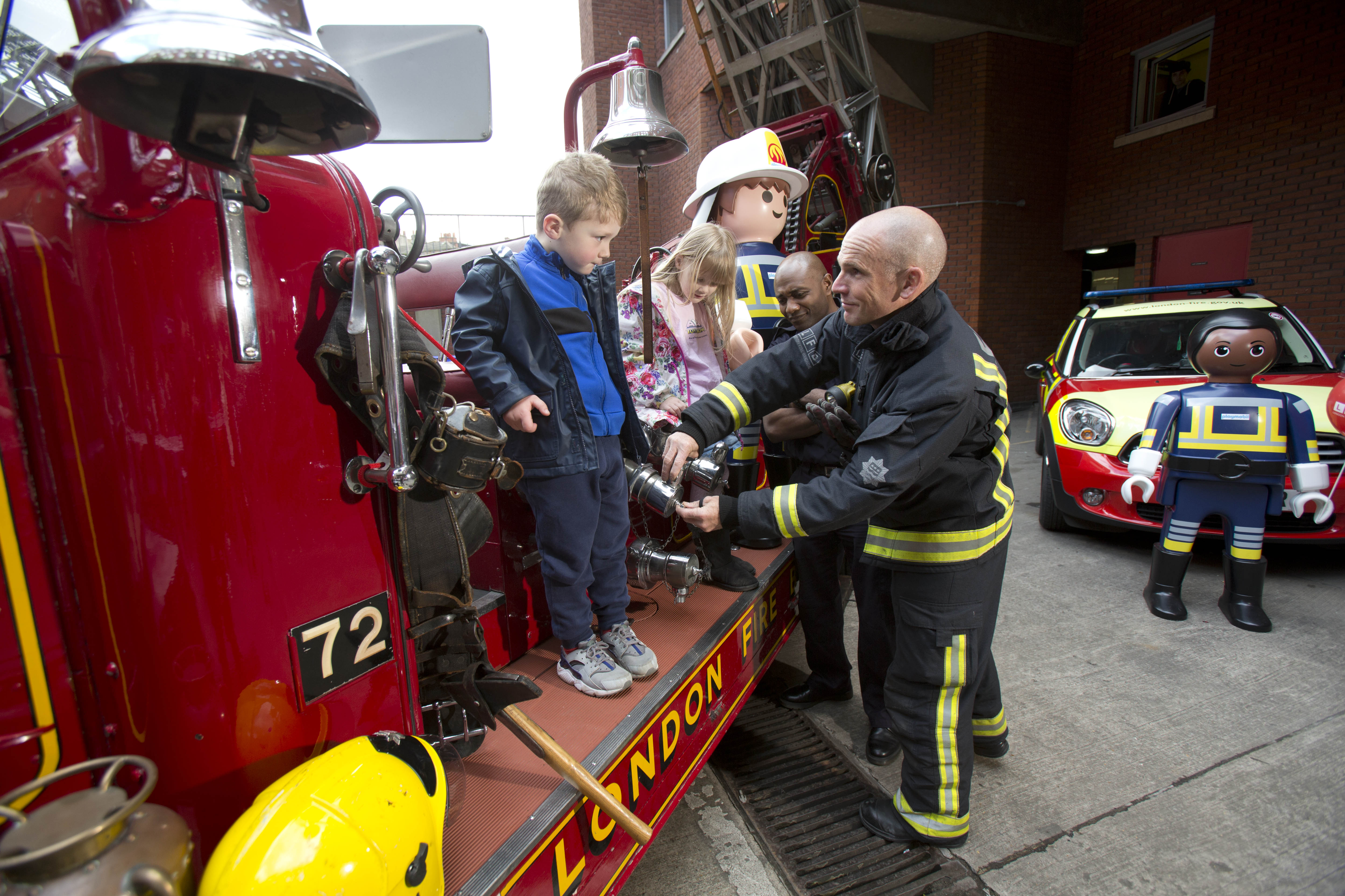 Playmobil partners with London Fire Brigade (LFB) to celebrate their 150th anniversary at Soho Fire Station yesterday (9th April, 2016) LFB firefighters use Playmobil toys and vintage engines to teach kids about fire safety at the launch of the BrigadeÕs 150th anniversary open days PIX:TIM ANDERSON