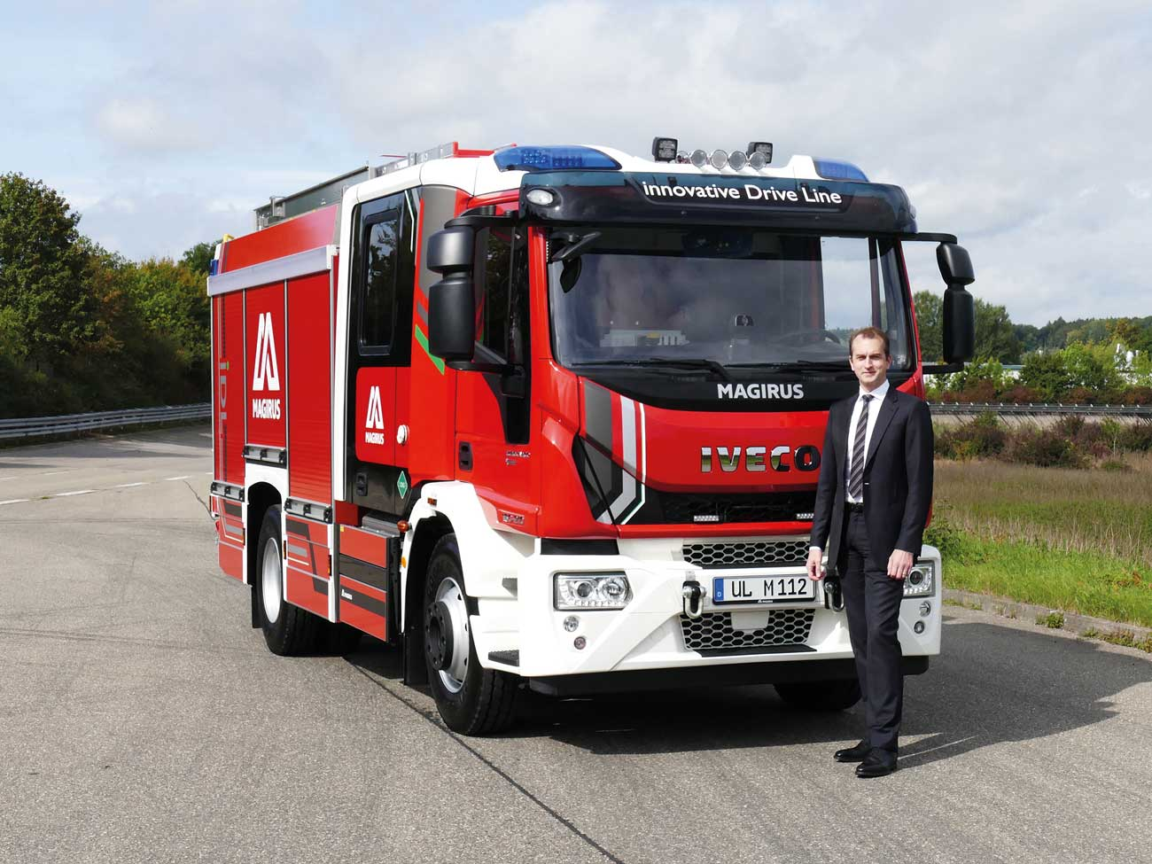 Marc Diening (CEO of Magirus) in front of the world's first CNG-powered fire engine.