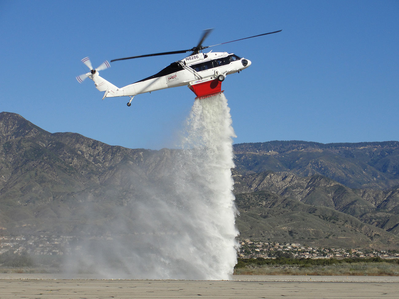 The Helitak FT4500 UH60/S70 Fire Tank dropping 1,100 gallons in 4.5 seconds.