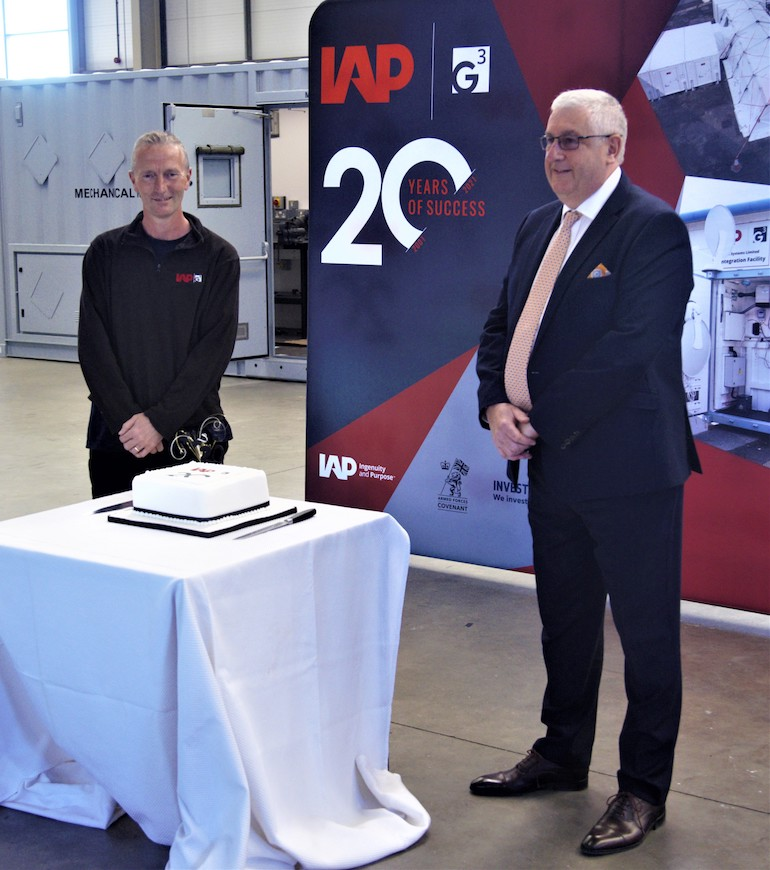 Managing Director Mike Puckett (right) and G3 Systems longest serving employee, Phil Sewell (left) celebrate the 20th Anniversary with a cake cutting at G3's Portland headquarters.