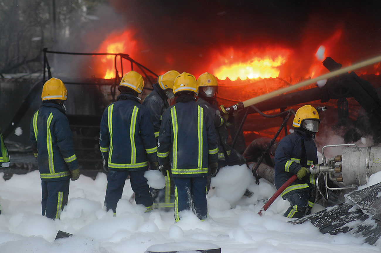 Fig 1. Would you allow these firefighters near flammable hydrocarbons, if this was an F3 blanket? Without fuel-shedding or vapour-sealing additives? (Protection here was reliable, effective fluorinated foams).