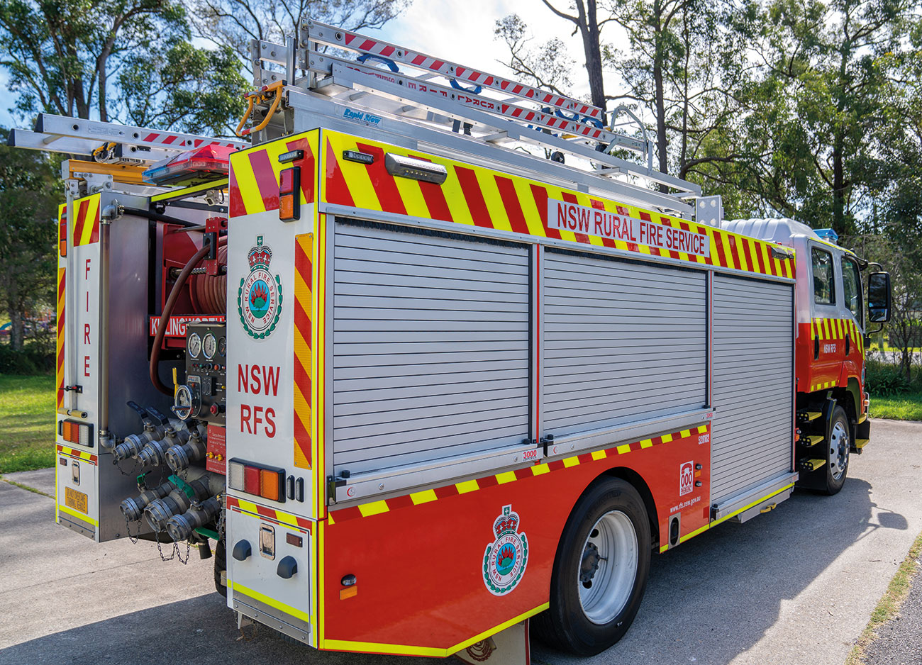 NSW Rural Fire Service Appliance fitted with Centurion3000 Vehicle Roller Doors, ARION 9.2m Double Extension Rescue Ladder with RapidStow MAX equipment gantry and an ARION 4.5m Folding Roof Ladder with RapidStow equipment gantry.