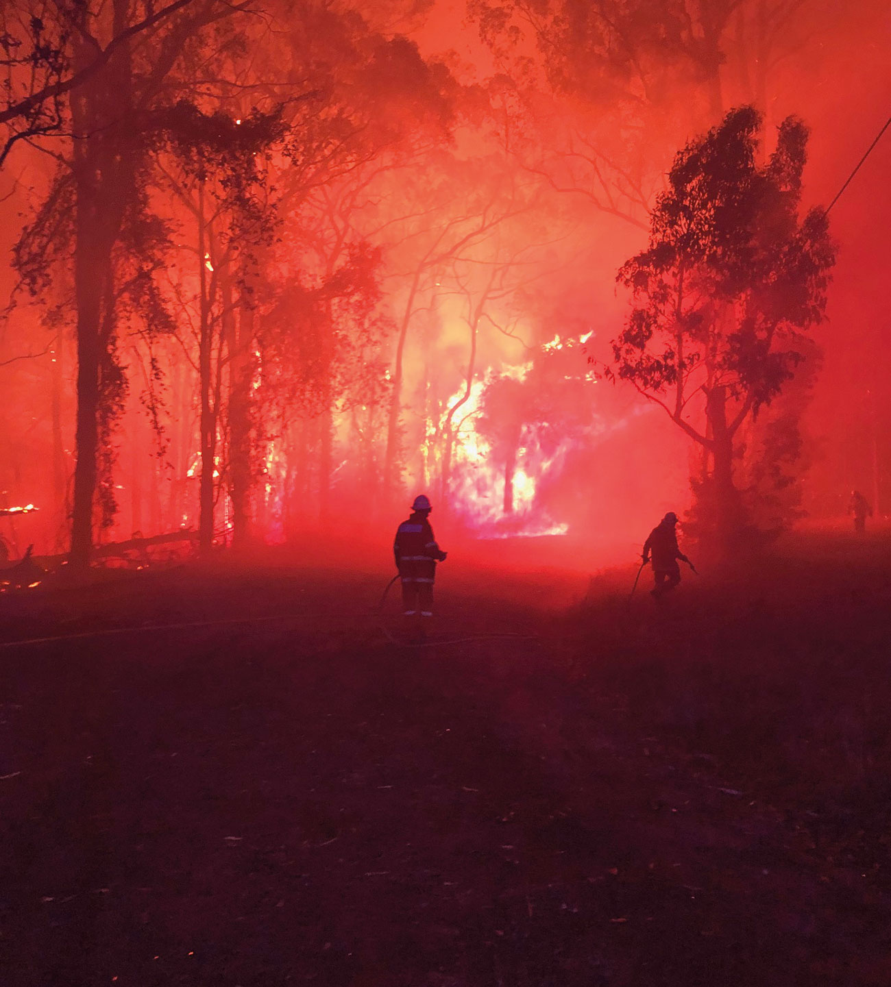 Fire engulfed firefighters as they defended properties in Mangrove Mountain, NSW, in December 2019.
