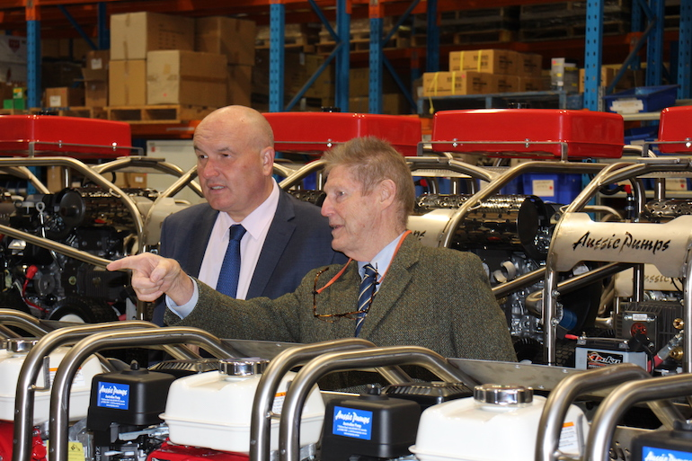 Aussie Pumps' Warwick Lorenz showing the Minister around the new production line at Castle Hill. (Aussie Pumps)