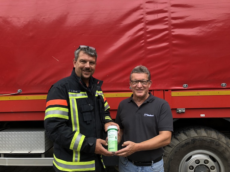 Alexander Krahe (left), Chief Fire Chief and Chairman of the Ahrweiler District Fire Brigade Association, met with Hans Alfter (right), Managing Director of Bullard GmbH, to receive the donation of De-Wipe disinfectant wipes organized by Bullard for further distribution. (Bullard)