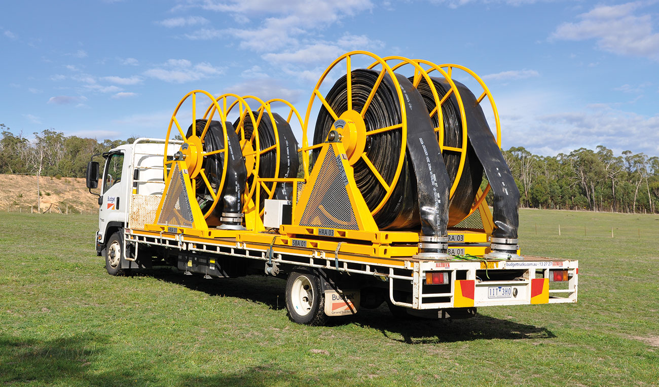 Hose reel system truck-mounted ready for deployment.