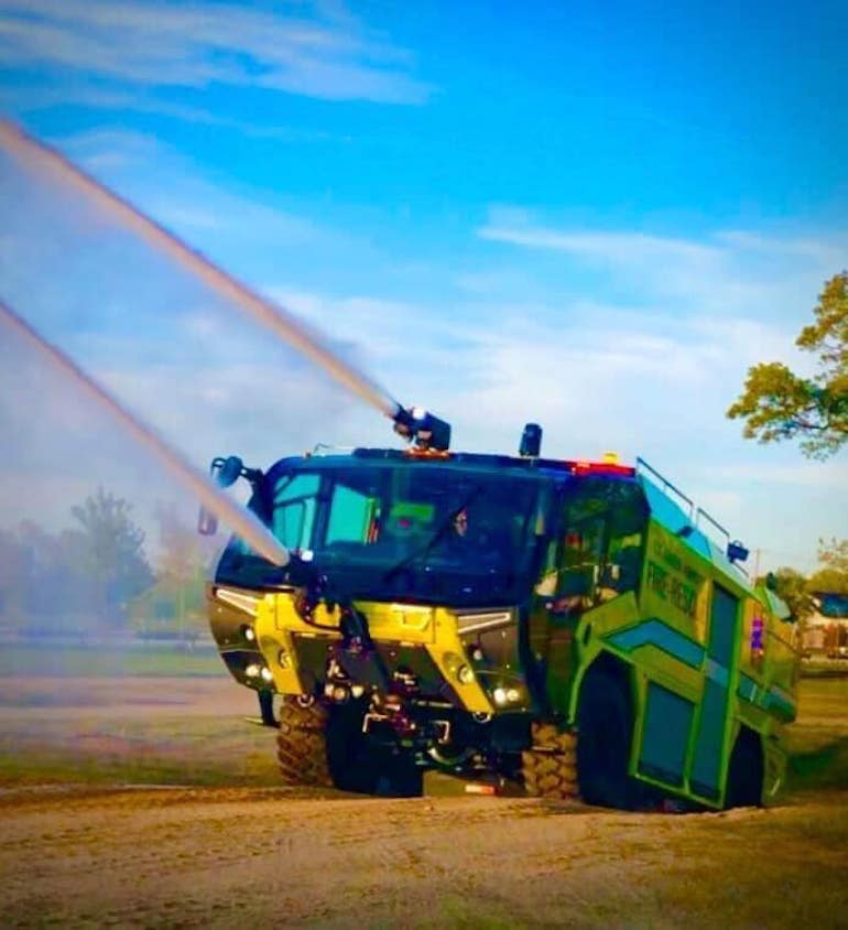 An ARFF (Aircraft Rescue & Firefighting) vehicle shown in action. (Photo by William Greenwood)